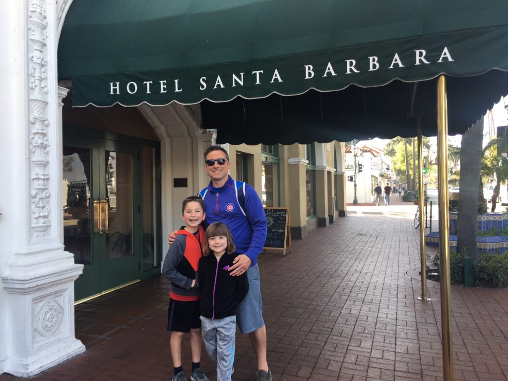 Father and two children under the Hotel Santa Barbara awning on State Street in Santa Barbara.