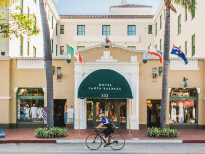 Hotel Santa Barbara with cyclist riding by