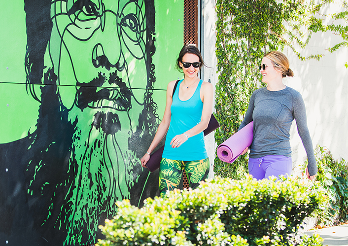Women walking with yoga mats