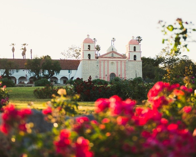 the santa barbara mission seen through the roses at the rose garden