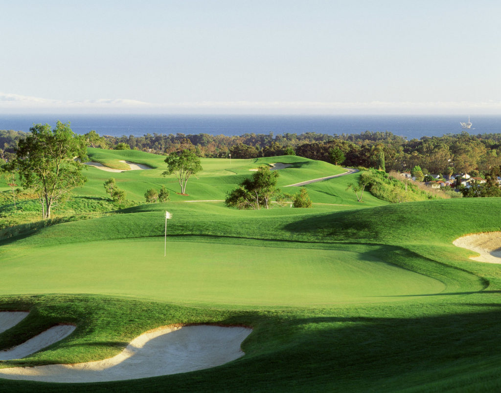 Green golf course in Santa Barbara with views of the ocean.
