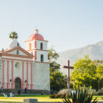 santa barbara mission with mountains in the background