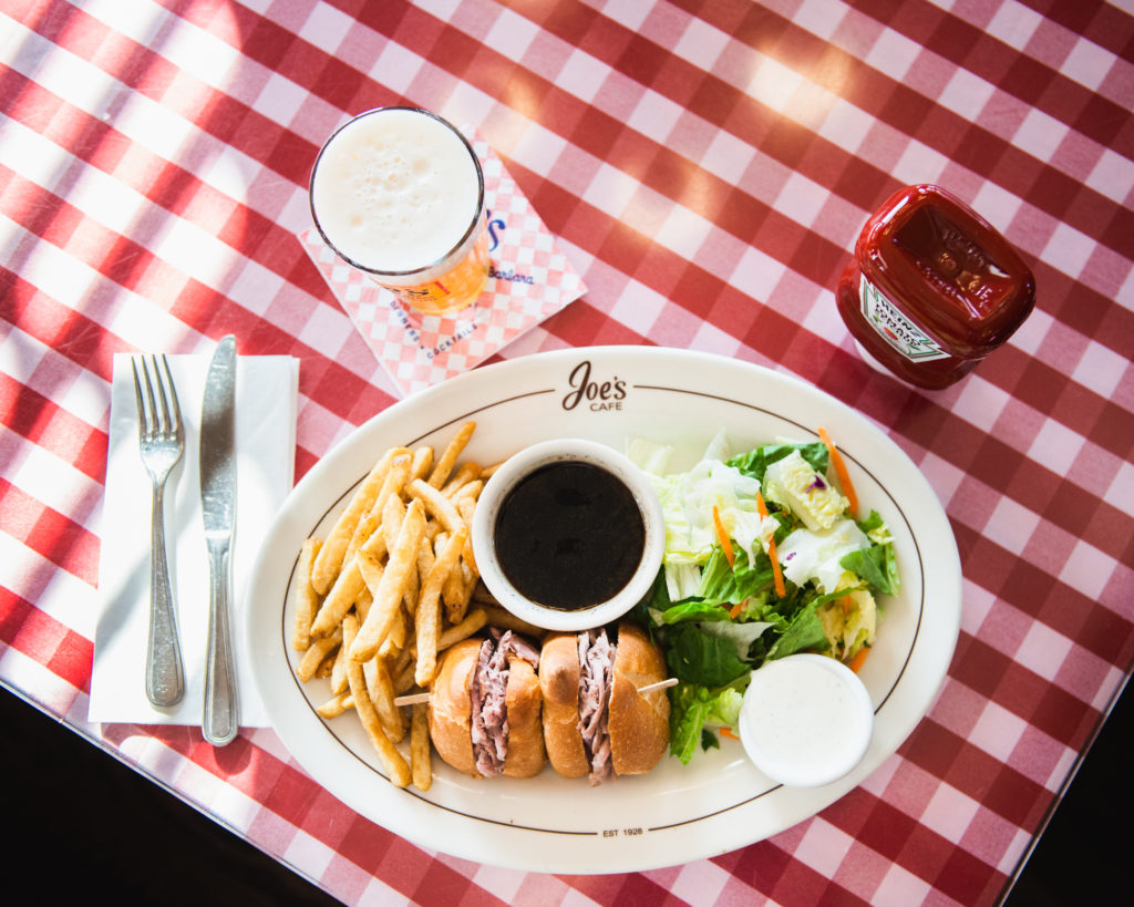 Plate of food from Joe's Cafe on red checked tablecloth.
