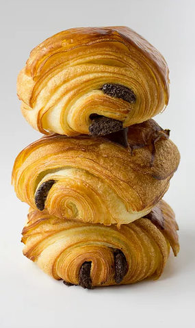 3 chocolate croissants stacked on top of each other
