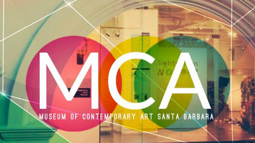 window of Museum of Contemporary Art Santa Barbara showing the label and looking into the inside