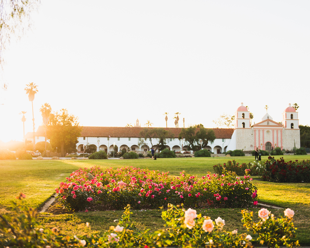 view of old mission santa barbara from rose gardens