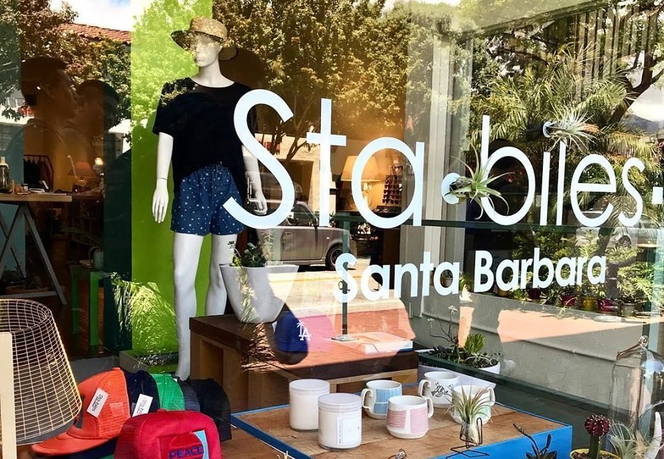 outside the Stabiles storefront, view looking through the window with the Stabiles decal